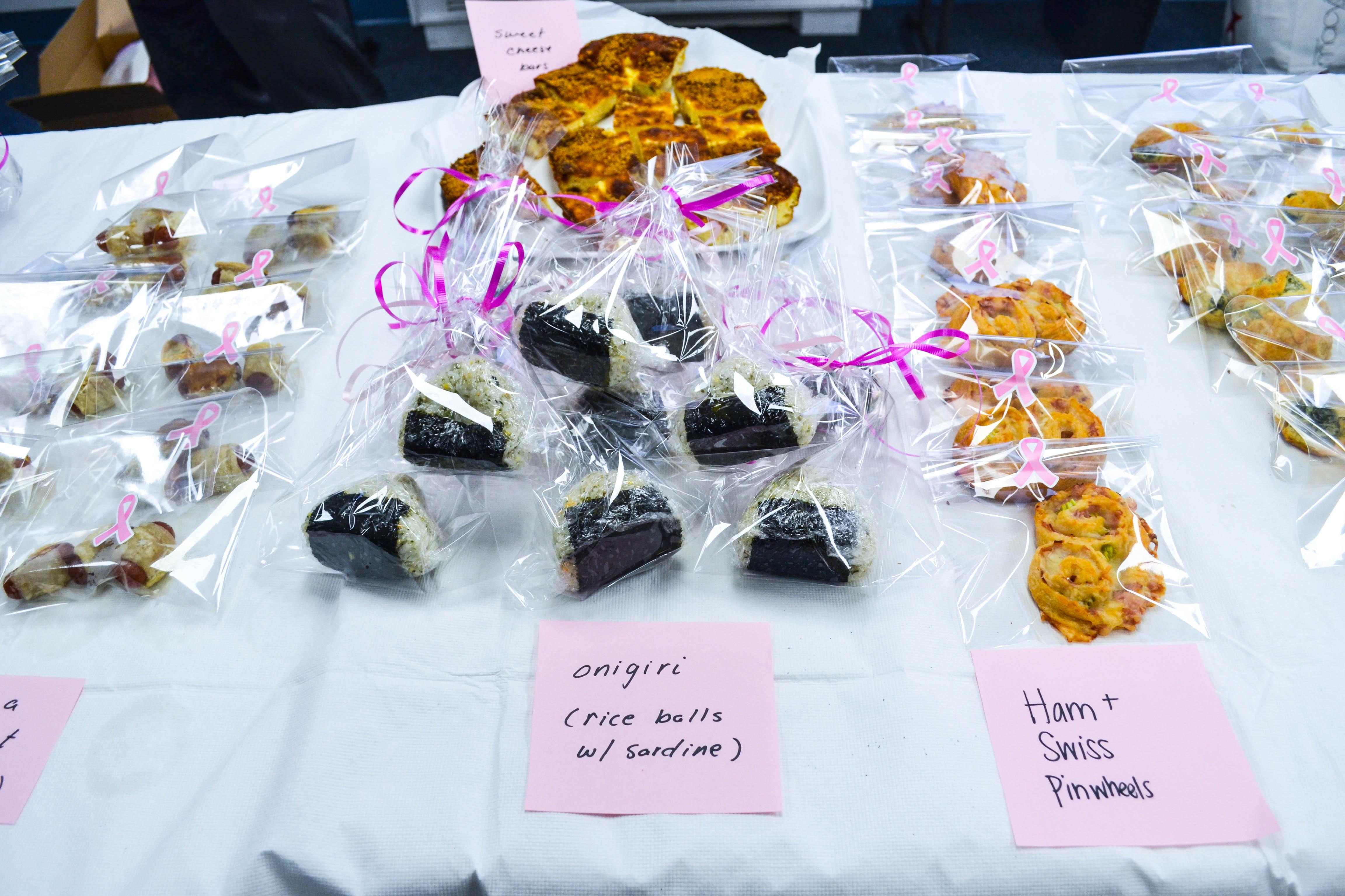 Onigiri and baked pinwheels sold at Diplomatic Language Services Susan G. Komen Bake Sale