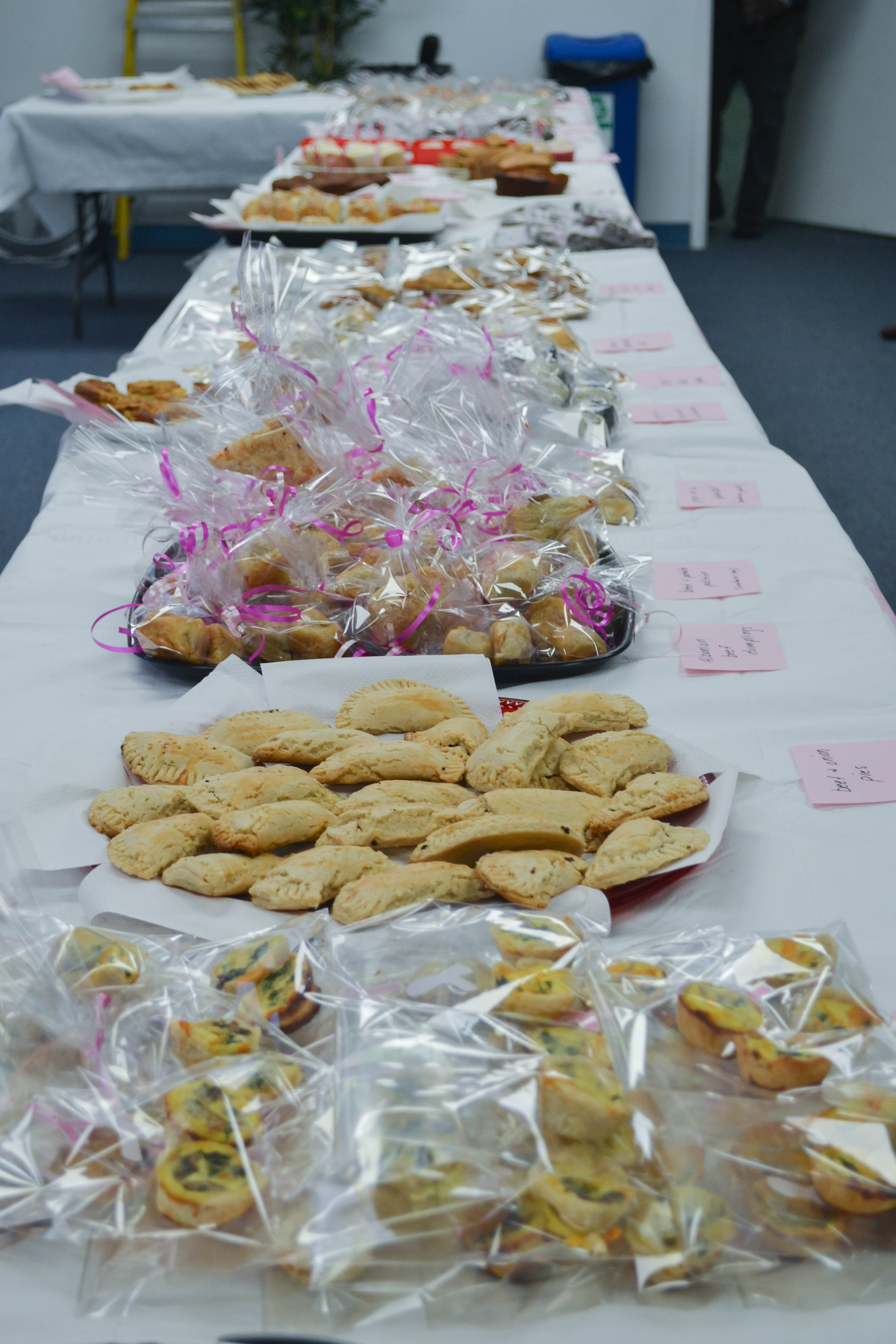 Baked goods displayed at Diplomatic Language Services Race For The Cure Bake Sale